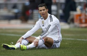 Real Madrid's Cristiano Ronaldo sits on the pitch during their Spanish first division soccer match against Atletico Madrid at the Vicente Calderon stadium in Madrid, February 7, 2015.         REUTERS/Juan Medina (SPAIN  - Tags: SPORT SOCCER)